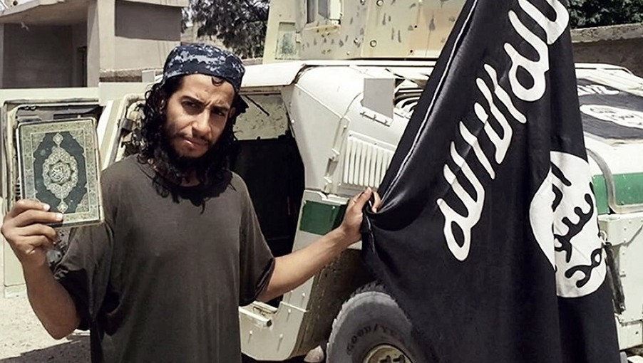 "An undated picture taken on November 16, 2015 from the February 2015 issue 7 of the Islamic State (IS) group online English-language magazine Dabiq, purportedly shows 27-year-old Belgian IS group leading militant Abdelhamid Abaaoud, also known as Abu Umar al-Baljiki and believed to be the mastermind of a jihadist cell dismantled in Belgium in January 2015, posing at an undisclosed location to illustrate an interview he gave to the magazine, claiming to have rejoined the extremist group in Syria. Flemish-language newspaper De Standaard reported that Brahim Abdeslam, one of the attackers who blew himself up during the Paris attacks last week, had links to Abaaoud, a Belgian of Moroccan descent who allegedly fought with the IS jihadist group in Syria and remains at large.  AFP PHOTO / HO / DABIQ === RESTRICTED TO EDITORIAL USE - MANDATORY CREDIT ""AFP PHOTO / HO / DABIQ"" - NO MARKETING NO ADVERTISING CAMPAIGNS - DISTRIBUTED AS A SERVICE TO CLIENTS FROM ALTERNATIVE SOURCES, AFP IS NOT RESPONSIBLE FOR ANY DIGITAL ALTERATIONS TO THE PICTURE'S EDITORIAL CONTENT, DATE AND LOCATION WHICH CANNOT BE INDEPENDENTLY VERIFIED === / AFP PHOTO / DABIQ / -"
