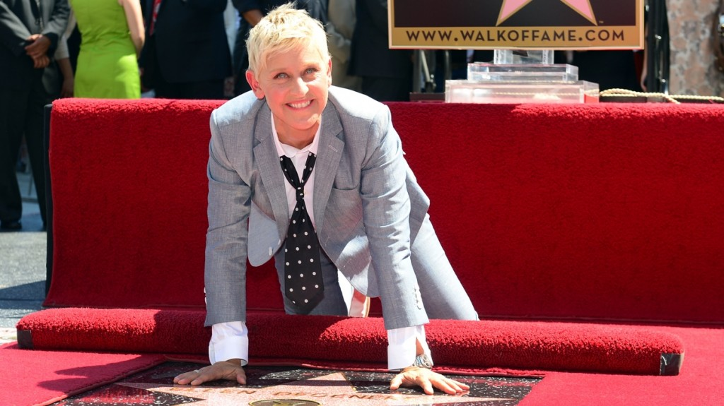 Television personality Ellen DeGeneres poses on her just unveiled Star along Hollywood Boulevard during a ceremony on September 4, 2012 in Hollywood, California. The hostess of 'The Ellen DeGeneres Show' which enters its tenth season on television on September 10th, is the recipient of the 2,477th Star on the Hollywood Walk of Fame.  AFP PHOTO / Frederic J. BROWN / AFP PHOTO / FREDERIC J. BROWN