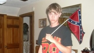 "This undated photo taken from Lastrhodesian .com on June 20, 2015 allegedly shows Dylann Roof.  A website surfaced Saturday with a white supremacist manifesto and dozens of photographs of the Charleston shooter holding weapons, burning an American flag and visiting historic sites in the US South. It was unclear who wrote the unsigned text filled with spelling mistakes or took the pictures of Dylann Storm Roof, accused of shooting nine people dead at a black church in the South Carolina city Wednesday. A section entitled ""an explanation"" reads: ""I have no choice. I am not in the position to, alone, go into the ghetto and fight."" AFP PHOTO/LASTRHODESIAN.COM/HANDOUT =  RESTRICTED TO EDITORIAL USE / MANDATORY CREDIT: ""AFP PHOTO HANDOUT/LASTRHODESIAN.COM""/ NO MARKETING - NO ADVERTISING CAMPAIGNS / DISTRIBUTED AS A SERVICE TO CLIENTS= / AFP PHOTO / LASTRHODESIAN.COM / Handout"