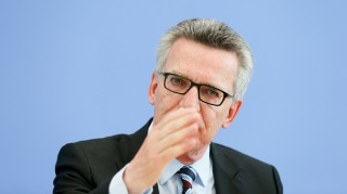 German Federal Interior Minister Thomas de Maiziere presents the 2015 police crime statistics and 2015 politially-motivated crimes at the Federal Press Conference in Berlin,Germany, 23 May 2016. Photo:KAYNIETFELD/dpa