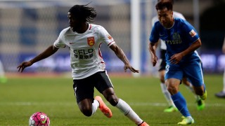 GUANGZHOU, CHINA - MARCH 4: Gervais Yao Kouassi of Hebei China Fortune (L) in action during the China Super League match between Guangzhou R&F and Hebei China Fortune FC at the Yuexiushan Stadium on March 4, 2016 in Guangzhou, China. Stringer / Anadolu Agency