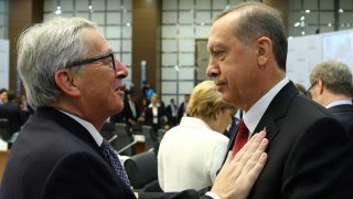 ANTALYA, TURKEY - NOVEMBER 16: Turkish President Recep Tayyip Erdogan (R) talks to European Commission President Jean-Claude Juncker (L) prior to a working session on day two of the G20 Turkey Leaders Summit on November 16, 2015 in Antalya, Turkey. Kayhan Ozer / Anadolu Agency