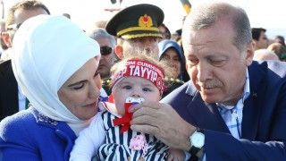 ISTANBUL, TURKEY - MAY 29: Turkish President Recep Tayyip Erdogan (R) and his wife Emine Erdogan (L) take care with a baby  during the celebrations of the 563rd anniversary of Istanbul's conquest by Turks at Yenikapi Event Area in Istanbul, Turkey on May 29, 2016. On May 29, 1453, Ottoman Sultan Mehmed II (Mehmet the Conqueror) conquered Istanbul, then called Constantinople, from where the Byzantines had ruled the Eastern Roman Empire for more than 1,000 years. The conquest transformed the city, once the heart of the Byzantine realm, into the capital of the new Ottoman Empire.  Kayhan Ozer / Anadolu Agency
