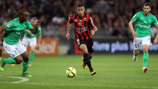 """Nice's French forward Hatem Ben Arfa (R) vies with Saint-Etienne's French defender Kevin Theophile-Catherine (L) during the French L1 football match Nice vs Saint Etienne on May 7, 2016 at the """"Allianz Riviera"""" stadium in Nice, southeastern France. / AFP PHOTO / VALERY HACHE"""