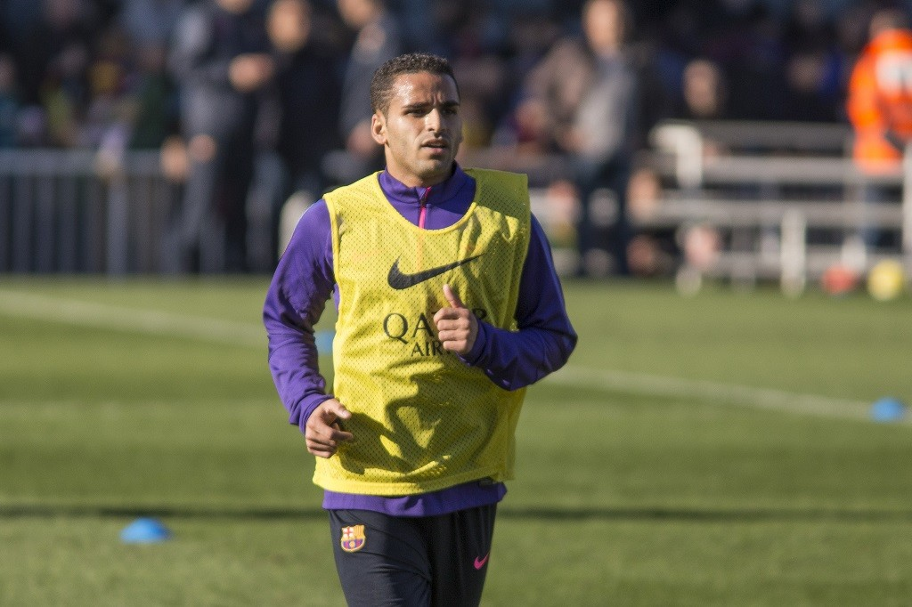 SPAIN, Barcelona: FC Barcelona's Douglas Pereira jogs down the field during the team's open training session at Mini Estadi in Barcelona, Spain on January 5, 2015. These open sessions have become a post-Christmas tradition for the team. Absent from the training was star player Lionel Messi, who was reportedly out sick.  CITIZENSIDE/MIQUEL LLOP