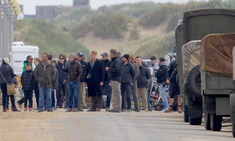 Filming takes place on the Christopher Nolan directed war movie 'Dunkirk' in the exact spot where, 76 years ago to this week, 100,000 soldiers were evacuated. During filming a number of locals were stopped from entering the beach with one person in a land yacht coming very close to driving straight across the set. Three warships circled off the coast adding to the war-like atmosphere while cast members held up cutouts of soldiers to create the illusion of more people in battle.Featuring: Christopher NolanWhere: Dunkirk, FranceWhen: 23 May 2016Credit: WENN.com