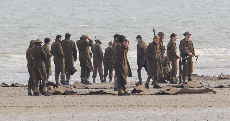 Filming takes place on the Christopher Nolan directed war movie 'Dunkirk' in the exact spot where, 76 years ago to this week, 100,000 soldiers were evacuated. During filming a number of locals were stopped from entering the beach with one person in a land yacht coming very close to driving straight across the set. Three warships circled off the coast adding to the war-like atmosphere while cast members held up cutouts of soldiers to create the illusion of more people in battle.Featuring: AtmosphereWhere: Dunkirk, FranceWhen: 23 May 2016Credit: WENN.com