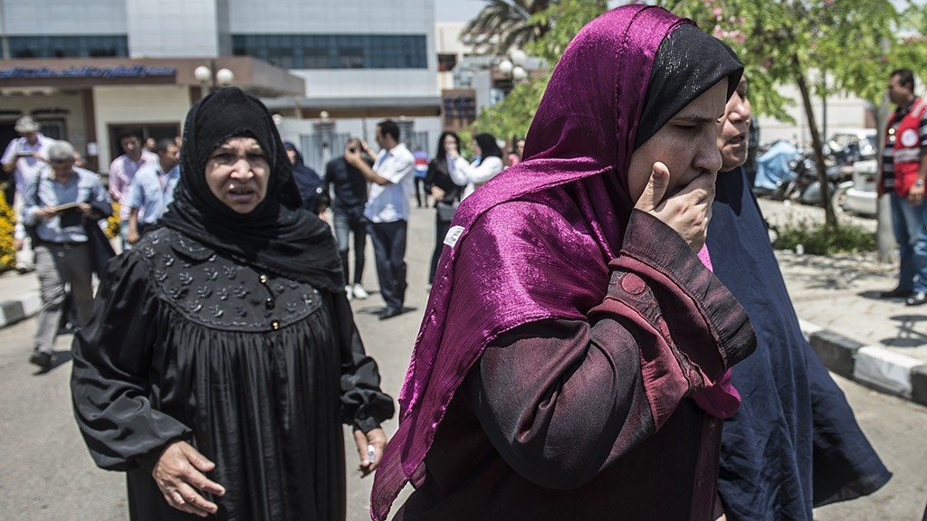 Family members of passengers who were flying aboard an EgyptAir plane that vanished from radar en route from Paris to Cairo overnight get ready to be transported by bus to a gathering point at Cairo airport on May 19, 2016. 
