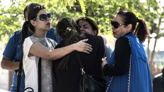 Families of passengers who were flying in an EgyptAir plane that vanished from radar en route from Paris to Cairo react as they wait outside a services hall at Cairo airport on May 19, 2016.The EgyptAir flight that vanished over the Mediterranean was carrying 30 Egyptian and 15 French passengers, as well as a Briton and a Canadian, the airline said. / AFP PHOTO / KHALED DESOUKI