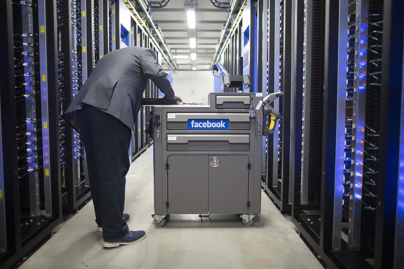 """An employee inspects a tool and maintenance box, also known as a """"crash cart"""" in the server hall at Facebook Inc.'s new data storage center near the Arctic Circle in Lulea, Sweden, on Wednesday, June 12, 2013. The data center is Facebook's first outside the U.S., poised to handle all data processing from Europe, Middle East and Africa and the server hub is largest of its kind in Europe, and most northerly of its magnitude anywhere on earth. Photographer: Simon Dawson/Bloomberg via Getty Images"""