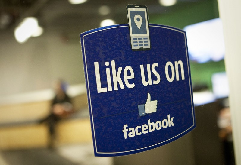 """A sign that reads """"Like us on Facebook"""" is displayed in the entry way at Facebook Inc.'s office in New York, U.S., on Tuesday, Dec. 20, 2011. """"Cool spaces"""" will spread to U.S. cities outside major Internet hubs as tech-savvy workers across industries spend more time at work and conduct their lives from hand held devices, said Peter Rummell, a developer in Jacksonville, Florida, and chairman of the Urban Land Institute, a Washington-based trade group for investors, developers and planners. Photographer: Scott Eells/Bloomberg via Getty Images"""