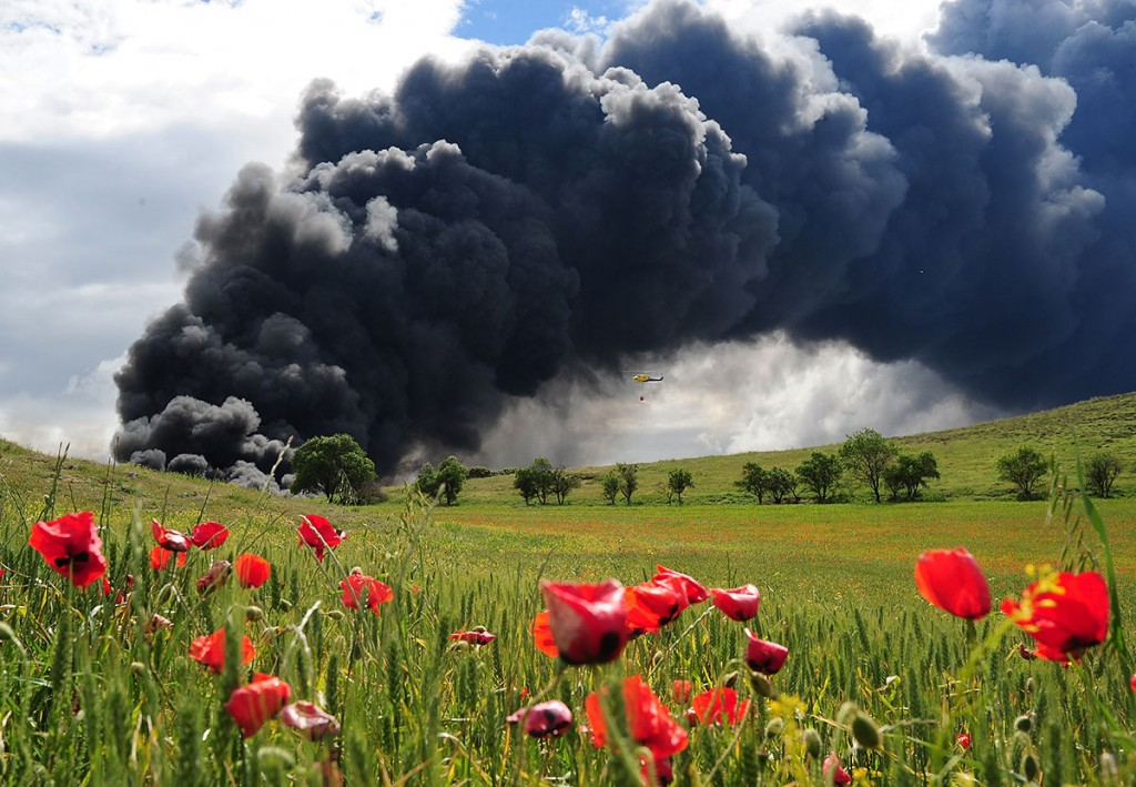 SESENA NUEVO, SPAIN - MAY 13:  Toxic smoke rises over the Castilla La Mancha countryside after an illegal tyre dump went on fire on May 13, 2016 in Sesena Nuevo, Spain. The dump, which stored over 75.000 tonnes of used rubber tyres was declared illegal in 2003 but both the Regional Government of Madrid and Castilla La Mancha were unable to come to an agreement as to who would pay for the estimated 4 million euro clean-up and removal of the dump.  (Photo by Denis Doyle/Getty Images)