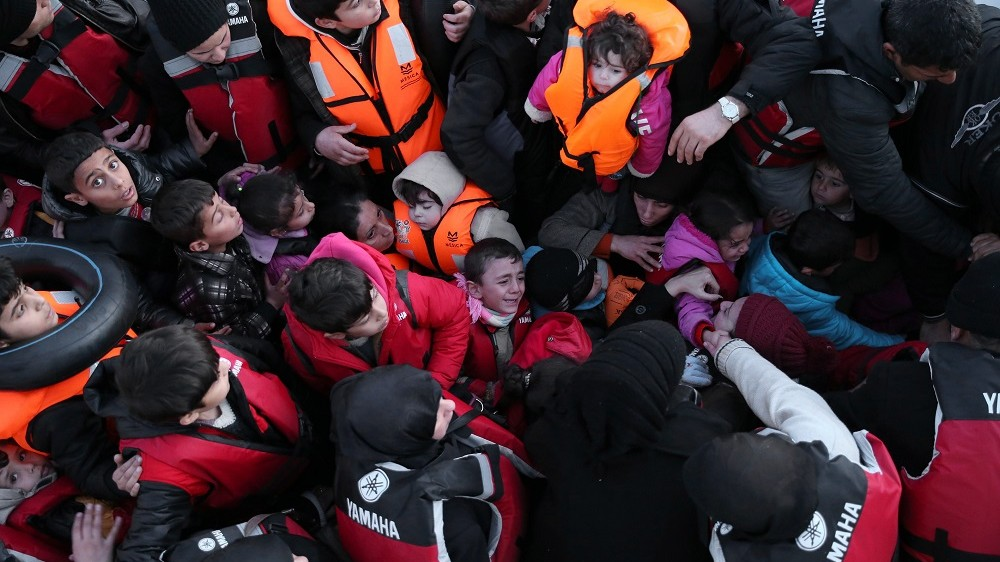 IZMIR, TURKEY - FEBRUARY 25: Syrian refugees, who tried to go to Greek Island Chios, are seen in a boat after they were caught  by Turkish Coast Guard ship TCSG Umut (Hope) near the Ciftlikkoy area in the Cesme district of Turkey on February 25, 2016.  (Photo by Mahmut Serdar Alakus/Anadolu Agency/Getty Images)