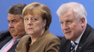 BERLIN, GERMANY - APRIL 14:  German Chancellor and head of the German Christian Democrats (CDU) Angela Merkel (C), Vice Chancellor and Economy and Energy Minister and head of the German Social Democrats (SPD) Sigmar Gabriel (L) and Bavarian Governor and head of the Bavarian Christian Democrats (CSU) Horst Seehofer speak to the media following an agreement by the three leaders, whose parties make up the current German coalition government, over new polices on April 14, 2016 in Berlin, Germany. The new policy intitiatives include measures to further the integration of refugees granted asylum status in Germany. Over one million migrants and refugees arrvied in Germany in 2015.  (Photo by Sean Gallup/Getty Images)
