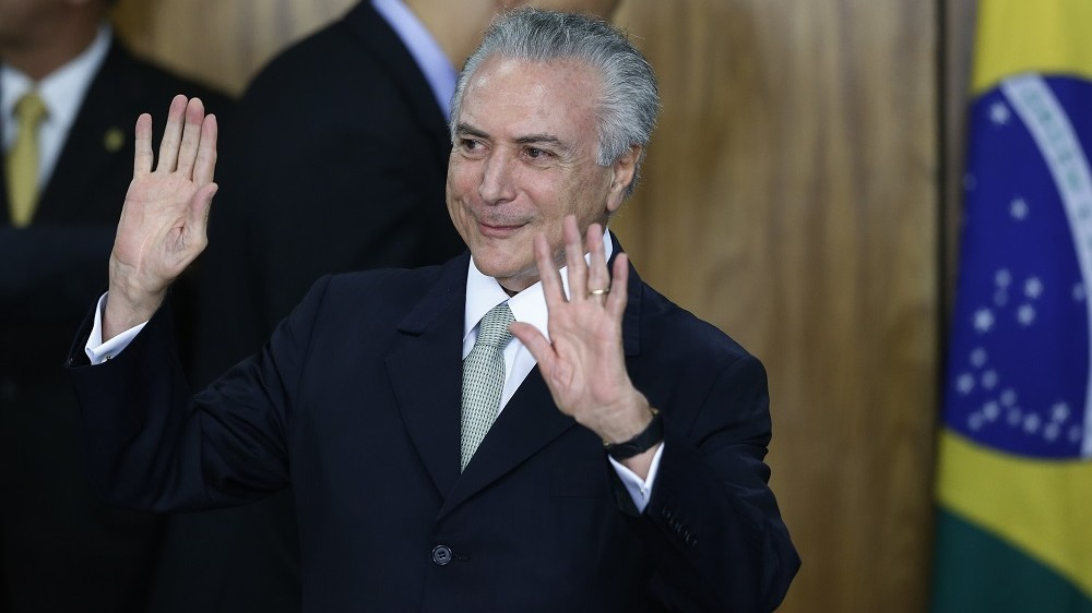 BRASILIA, BRAZIL - MAY 12: Brazil's interim President Michel Temer attends a signing ceremony for new government ministers at the Planalto presidential palace after the Senate voted to accept impeachment charges against suspended President Dilma Rousseff on May 12, 2016 in Brasilia, Brazil. Rousseff has been suspended from her presidential duties and will face a Senate trial for alleged manipulation of government accounts. (Photo by Igo Estrela/Getty Images)