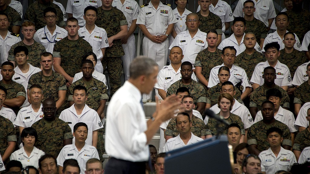 """US President Barack Obama speaks to US and Japanese troops during his visit to the Marine Corps Air Station at Iwakuni, near the Japanese city of Hiroshima on May 27, 2016.Obama, who arrived at Iwakuni after attending the G7 Summit in central Japan, hailed the """"great alliance"""" between the United States and Japan on May 27, just hours ahead of his historic visit to Hiroshima. / AFP PHOTO / JIM WATSON"""