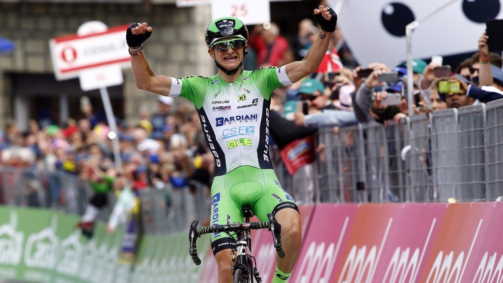 Italian cyclist Giulio Ciccone - team CSF, celebrates as he crosses the finish line to win the 10th stage of 99th Giro d'Italia, Tour of Italy, from Campi Bisenzio to Sestola on May 17, 2016 in Sestola, Italy.   Italian Giulio Ciccone won the tenth stage of the Giro d'Italia ahead of Ivan Rovny and Darwin Atapuma / AFP PHOTO / LUK BENIES