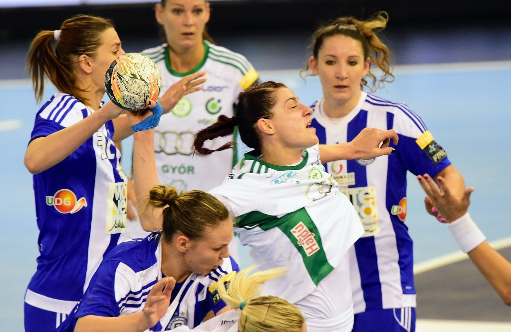 Eduarda Amorim (C) of Hungarian Gyori Audi ETO KC is pushed by defenders of MNE Budocnost  during the EHF Women's Champions League Final Four semi-final match of HUN Gyori Audi ETO KC vs MNE Budocnost  at the Papp Laszlo Arena in Budapest on May 7, 2016. Gyor won 21-20 and made it to the tomorrow's final.   / AFP PHOTO / ATTILA KISBENEDEK