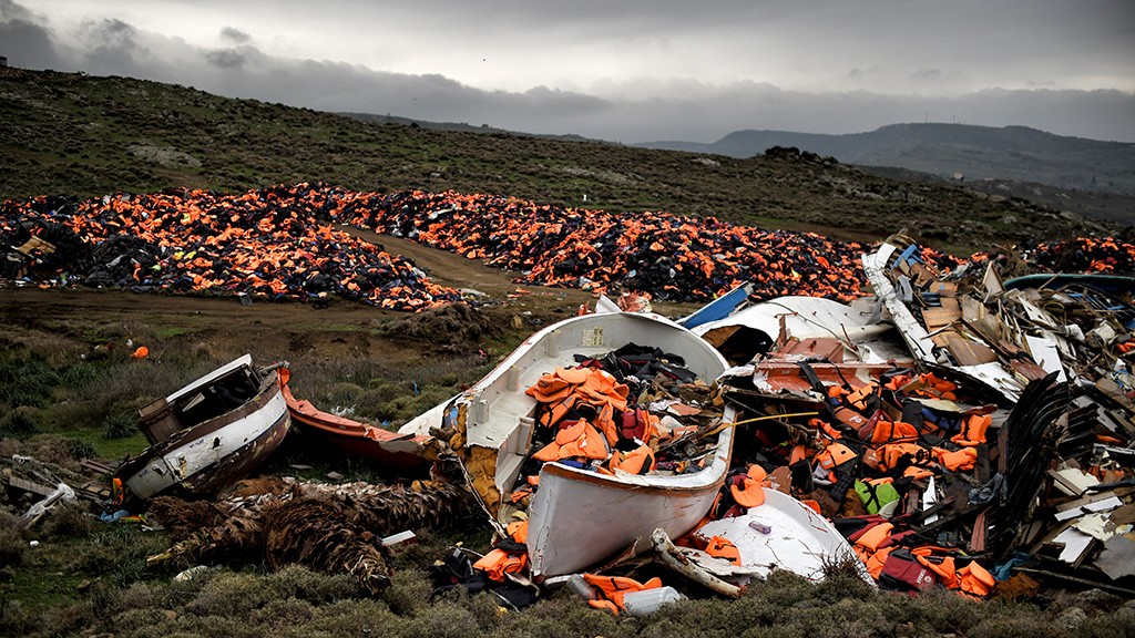 Wrecked boats and thousands of life jackets used by refugees and migrants during their journey across the Aegean sea lie in a dump in Mithimna on February 19, 2016.