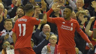 Liverpool's English striker Daniel Sturridge (R) celebrates after scoring his team's second goal during the UEFA Europa League semi-final second leg football match between Liverpool and Villarreal CF at Anfield in Liverpool, northwest England on May 5, 2016. / AFP PHOTO / LLUIS GENE