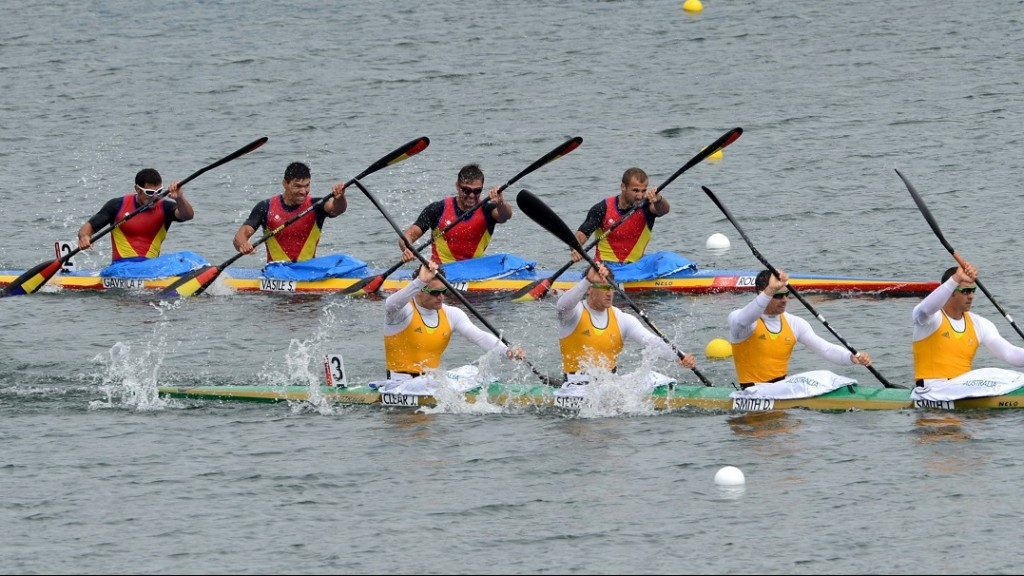 (Foreground R-L) Australia's Tate Smith, Dave Smith, Murray Stewart and Jacob Clear and (R-L, back) Romania's Traian Neagu, Toni Ioneticu, Stefan Vasile and Petrus Gavrila compete in the kayak four (K4) 1000m men's semifinal 1 during the London 2012 Olympic Games, at Eton Dorney Rowing Centre in Eton, west of London, on August 7, 2012.   AFP PHOTO / DAMIEN MEYER / AFP PHOTO / DAMIEN MEYER