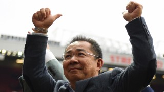 Leicester City's Thai chairman Vichai Srivaddhanaprabha gives a thumbs up to fans after the English Premier League football match between Manchester United and Leicester City at Old Trafford in Manchester, north west England, on May 1, 2016. / AFP PHOTO / OLI SCARFF / RESTRICTED TO EDITORIAL USE. No use with unauthorized audio, video, data, fixture lists, club/league logos or 'live' services. Online in-match use limited to 75 images, no video emulation. No use in betting, games or single club/league/player publications.  /