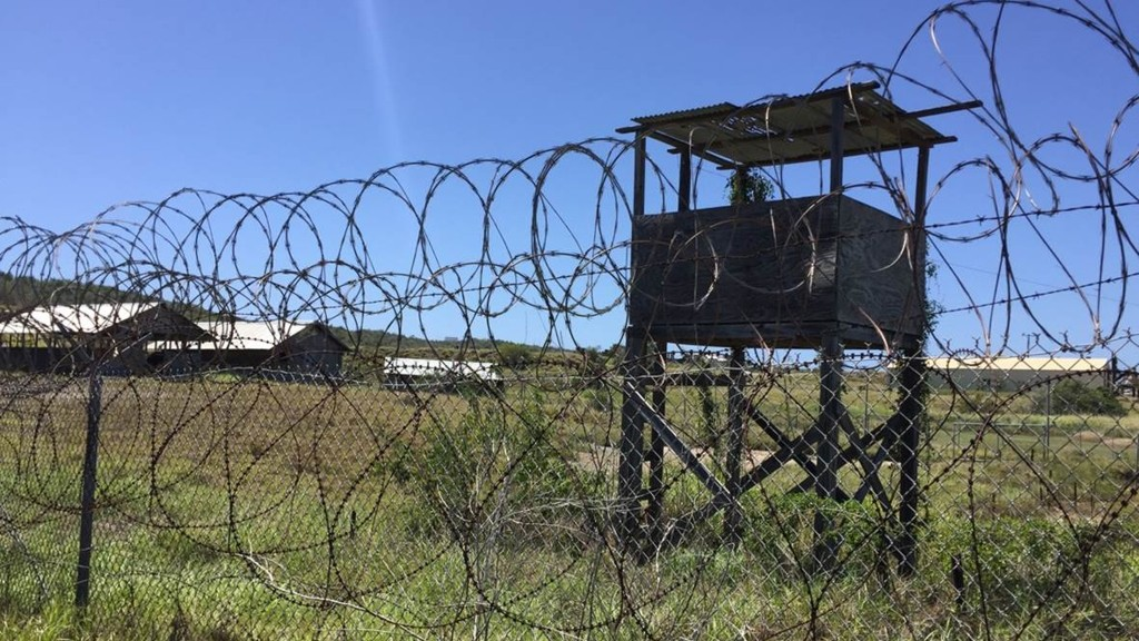 Nature reclaims the US military's  Camp X-Ray at Guantanamo Bay Naval base on March 9, 2016, in Guantanamo Bay, Cuba.  The infamous holding center closed 14 years ago and inmates were moved to more permanent facilities. Despite more than seven years of attempts by US President Barack Obama, Guantanamo Bay will likely remain a detention center for years to come. / AFP PHOTO / Thomas WATKINS