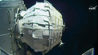 "This still handout image from video obtained May 28, 2016 courtesy of NASA shows an inflatable add-on room, known as the Bigelow Expandable Activity Module (BEAM), at the International Space Station (ISS).   NASA tried again on May 28, 2016 to inflate an add-on room at the International Space Station, after the first attempt ran into problems due to too much friction. Efforts to inflate the flexible habitat got under way at about 9 am (1300 GMT).  Space scientists monitoring the expansion at mission control in Houston, Texas  expressed optimism that they were having early success this time around, as images on NASA television showed the module slowly expanding after receiving three initial bursts of air.  / AFP PHOTO / NASA / RESTRICTED TO EDITORIAL USE - MANDATORY CREDIT ""AFP PHOTO / NASA"" - NO MARKETING - NO ADVERTISING CAMPAIGNS - DISTRIBUTED AS A SERVICE TO CLIENTS"