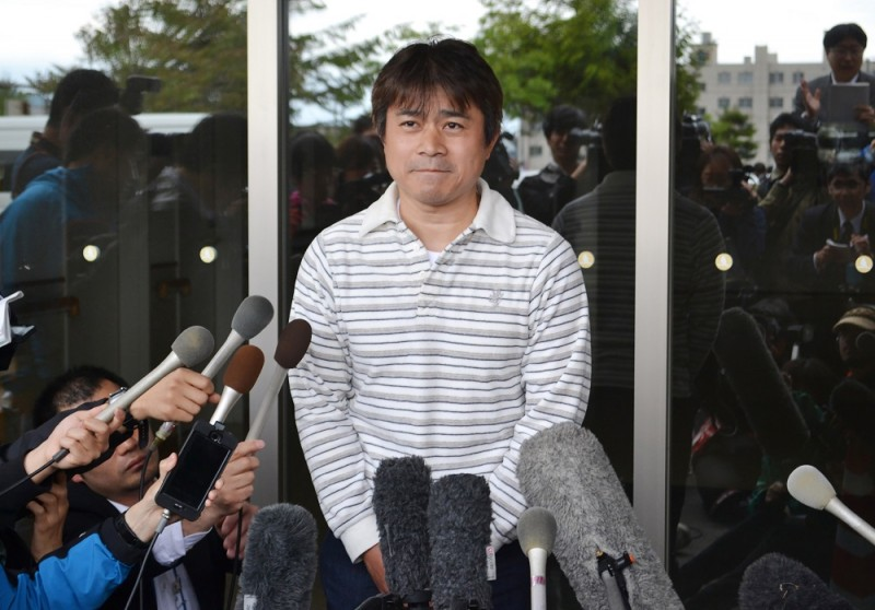 Takayuki Tanooka, father of Yamato Tanooka, a seven-year-old boy missing since being abandoned in a bear-inhabited forest in northern Japan, speaks to reporters in Hakodate on June 3, 2016.   The boy, apparently unharmed and in good health, was discovered at a military base. Reports said he had taken shelter in a hut and found a tap to drink from but was hungry and immediately asked for food when discovered. / AFP PHOTO / JIJI PRESS / JIJI PRESS / Japan OUT
