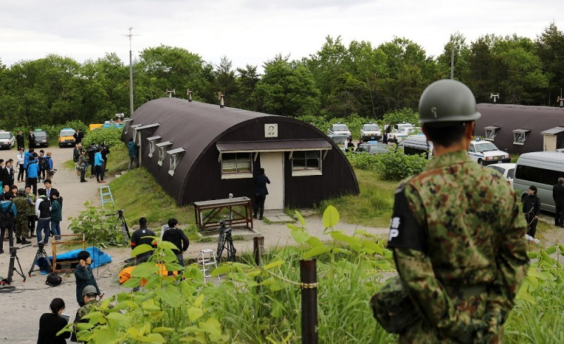 This picture shows a house in a military exercise area where missing boy Yamato Tanooka was found by Self-Defense Forces personnel in the town of Shikabe in Hokkaido on June 3, 2016. A missing seven-year-old boy who spent nearly a week sheltering in a hut after being abandoned by his parents in a bear-inhabited forest in northern Japan as a punishment was found alive on June 3, officials said. Yamato Tanooka was discovered inside a military base by a soldier about 5.5 kilometres (3.4 miles) from where he went missing last Saturday, apparently unharmed and in good health. / AFP PHOTO / JIJI PRESS / STR / Japan OUT