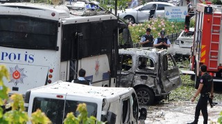 ALTERNATIVE CROP Police officers and rescuers inspect the site of a bomb attack that targeted a police bus in the Vezneciler district of Istanbul on June 7, 2016. A bomb attack targeted Turkish police in a central Istanbul district on June 7, 2016, leaving several people wounded, the state-run TRT television reported. / AFP PHOTO / DOGAN NEWS AGENCY / STRINGER / Turkey OUT