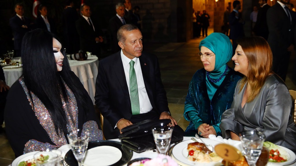 """This handout photo released by the Turkish Presidential Press Office on June 19, 2016 shows Turkish President Recep Tayyip Erdogan (2nd R), his wife Emine Erdogan (2nd L), Turkish trans celebrity and actress Bulent Ersoy (L) and Turkish singer Sibel Can (R) attending a ramandan dinner in Istanbul.  President Recep Tayyip Erdogan shared a Ramadan dinner with Turkey's best-known transgender celebrity hours after the Istanbul riot police broke up an LGBT rally. / AFP PHOTO / HANDOUT / KAYHAN OZER / RESTRICTED TO EDITORIAL USE - MANDATORY CREDIT """"AFP PHOTO /TURKISH PRESIDENTIAL PRESS OFFICE/ KAYHAN OZER"""" - NO MARKETING NO ADVERTISING CAMPAIGNS - DISTRIBUTED AS A SERVICE TO CLIENTS"""