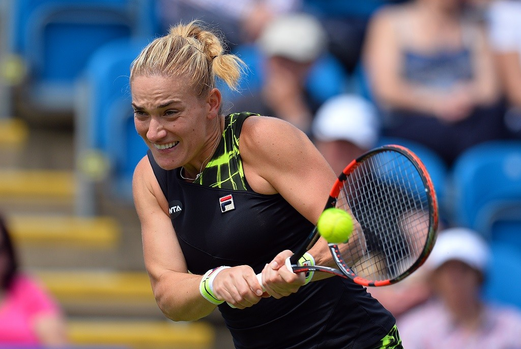 Hungary's Timea Babos returns to Czech Republic's Petra Kvitova during her women's singles match at the WTA Eastbourne International tennis tournament in Eastbourne, southern England on June 21, 2016. / AFP PHOTO / GLYN KIRK
