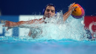 Andrija Prlainovic of Serbia looks to pass the ball during the men's final water polo match between Croatia and Serbia on day fifteen of the 16th FINA World Championships at the Water Polo Arena on August 8, 2015 in Kazan, Russia. Serbia won 11-4. AFP PHOTO / ROMAN KRUCHININ / AFP PHOTO / ROMAN KRUCHININ