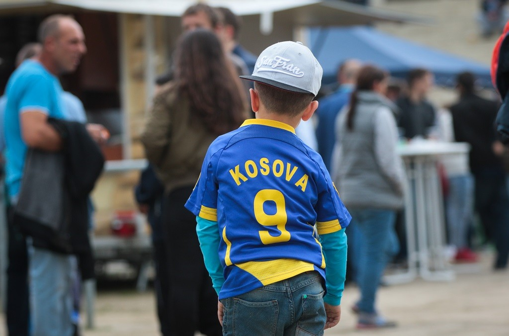 A young Kosovo fan in front of the stadium before the international soccer match between Kosovo and Faroe Islands at Frankfurter Volksbank-Stadion in Frankfurt (Main), Germany, 3 June 2016. In May 2016, Kosovo became the 55th member of UEFA, resulting in protests in Serbia. PHOTO: FRANK RUMPENHORST/dpa