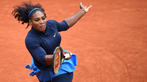 PARIS, FRANCE - JUNE 03: Serena Williams of US returns to Kiki Bertens (not seen) of Netherlands during the women's single semi final match at the French Open tennis tournament at Roland Garros Stadium in Paris, France on June 03, 2016. Mustafa Yalcin / Anadolu Agency