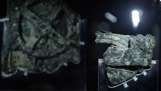 TO GO WITH AFP STORY BY SOPHIE MAKRIS  - A picture taken at the Archaeological Museum in Athens on September 14, 2014 shows pieces of the so-called Antikythera Mechanism, a 2nd-century BC device known as the world's oldest computer, which was discovered by sponge divers in 1900 off a remote Greek island in the Aegean,. The mechanism is a complex mechanical ďcomputerĒ which tracked astronomical phenomena and the cycles of the Solar System .       AFP PHOTO / LOUISA GOULIAMAKI / AFP PHOTO / LOUISA GOULIAMAKI