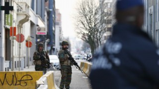 BRUSSELS, BELGIUM - MARCH 22: Soldiers and police officers stand guard outside EU Commission Headquarters following todays attack on March 22, 2016 in Brussels, Belgium. At least 31 people are thought to have been killed after Brussels airport and a Metro station were targeted by explosions. The attacks come just days after a key suspect in the Paris attacks, Salah Abdeslam, was captured in Brussels.  (Photo by Carl Court/Getty Images)