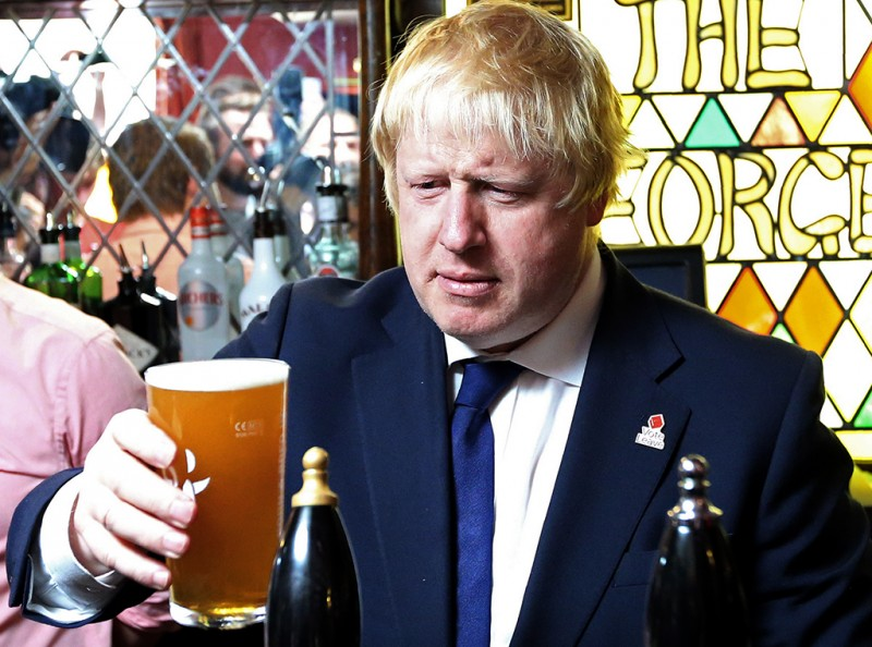 "Former London Mayor, and ""Vote Leave"" campaigner, Boris Johnson is pictured with a pint of beer ahead of meeting with members of the public and supporters in Piercebridge, near Darlington, north-east England on June 22, 2016, as he continues to campaign for a Brexit ahead of the June 23 EU referendum.