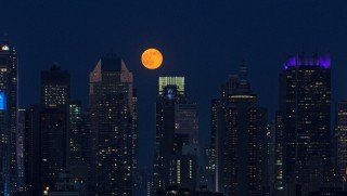 NEW YORK, NY - JUNE 20: The full moon rises above the skyscrapers in Manhattan, New York on June 20, 2016. For the first time since the Summer of Love in 1967, June's full moon, also known as the Strawberry Moon, coincided with the summer solstice. Volkan Furuncu / Anadolu Agency