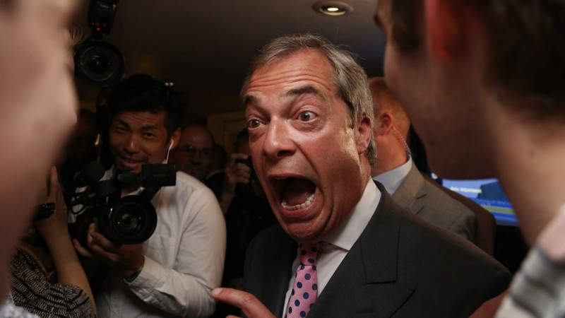 """Leader of the United Kingdom Independence Party (UKIP), Nigel Farage (C) reacts at the Leave.EU referendum party at Millbank Tower in central London on June 24, 2016, as results indicate that it looks likely the UK will leave the European Union (EU). Top anti-EU campaigner Nigel Farage said he was increasingly confident of victory in Britain's EU referendum on Friday, voicing hope that the result """"brings down"""" the European Union. / AFP PHOTO / GEOFF CADDICK"""