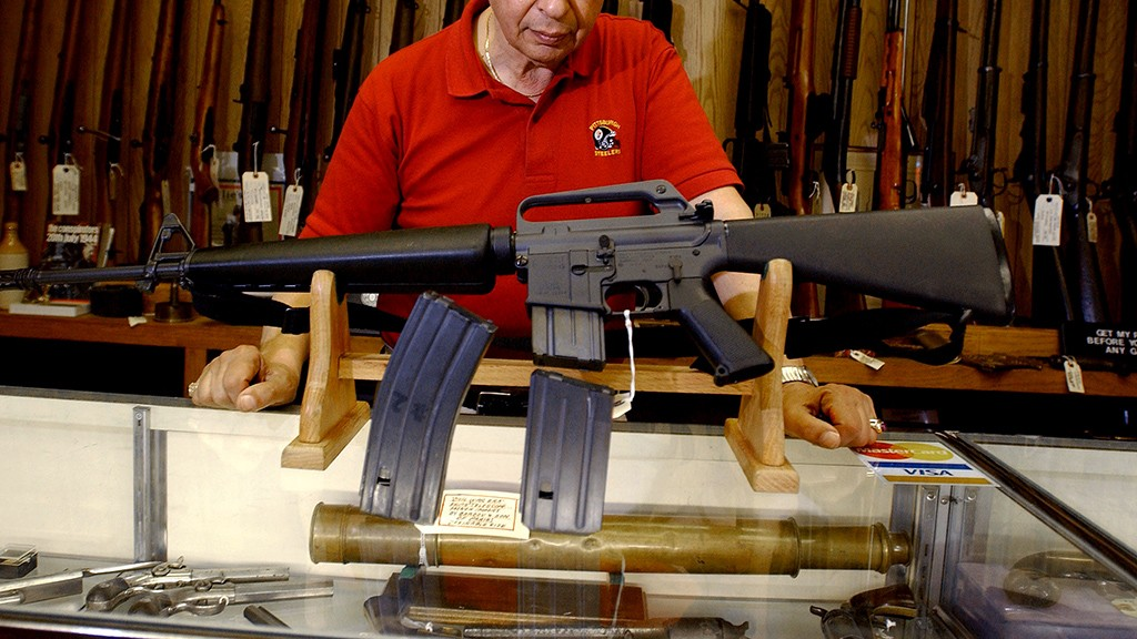 Gun shop manager Stephan Romanoff displays  an AR-15 rifle and two magazines 14 September, 2004 at the Allegheny River Arsenal in Pittsburgh, Pennsylvania. A US ban on the manufacture and possession of military-style assault weapons ended 13 September with a bitter dispute between political rivals and a debate over its effectiveness. (Jeff Swensen/Getty Images/AFP) FOR NEWSPAPERS AND TV USE ONLY / Getty Images / Getty Images North America / Jeff Swensen