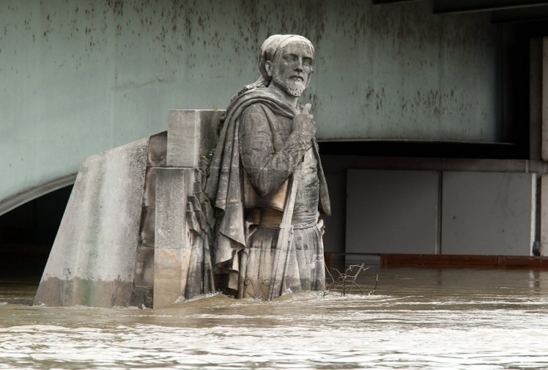 PARIS, FRANCE - JUNE 03:  The Zouave statue under the Pont de l'Alma is half covered by the rising waters from the Seine River after four days of rainy weather on June 3, 2016 in Paris. The 'Ile de France' Region and Paris are particularly affected by heavy flooding after the torrential rains in recent days. (Photo by Xavier Laine/Getty Images)