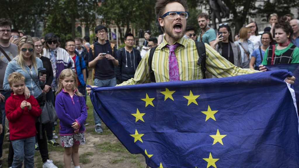 LONDON, ENGLAND - JUNE 25:  A small group of people gather to protest on Parliament Square the day after the majority of the British public voted to leave the European Union on June 25, 2016 in London, England. The ramifications of the historic referendum yesterday that saw the United Kingdom vote to Leave the European Union are still being fully understood. The Labour leader, Jeremy Corbyn, who is under pressure from within his party to resign has blamed the 'Brexit' vote on 'powerlessness', 'austerity' and peoples fears over the issue of immigration.  (Photo by Dan Kitwood/Getty Images)