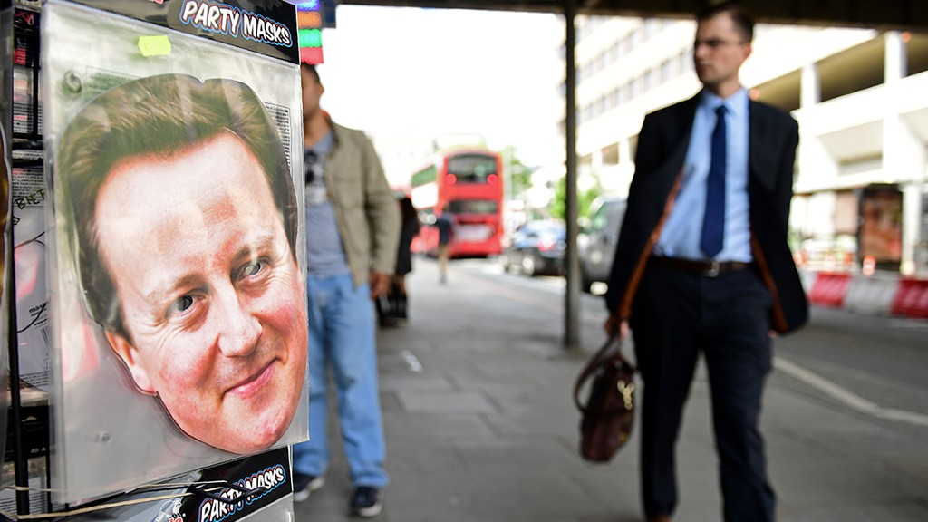 Novelty face masks including one of British Prime Minister David Cameron, are displayed for sale on a street vendor's stall in London, on June 24, 2016. Britain voted to break away from the European Union on June 24, toppling Prime Minister David Cameron and dealing a thunderous blow to the 60-year-old bloc that sent world markets plunging. / AFP PHOTO / LEON NEAL