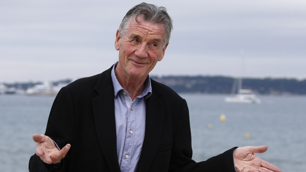 """British actor Michael Palin poses during a photocall for the TV show """"Clangers"""" at the MIPCOM audiovisual trade fair in Cannes, southeastern France, on October 6, 2015. Held each year on the French Riviera, the audiovisual trade fair brings together the movers and shakers of the global entertainment business to network, talk shop and buy, sell and finance new content. AFP PHOTO / VALERY HACHE / AFP PHOTO / VALERY HACHE"""