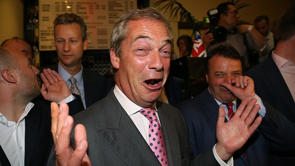 """Leader of the United Kingdom Independence Party (UKIP), Nigel Farage (C) reacts at the Leave.EU referendum party at Millbank Tower in central London on June 24, 2016, as results indicate that it looks likely the UK will leave the European Union (EU).Top anti-EU campaigner Nigel Farage said he was increasingly confident of victory in Britain's EU referendum on Friday, voicing hope that the result """"brings down"""" the European Union. / AFP PHOTO / GEOFF CADDICK"""