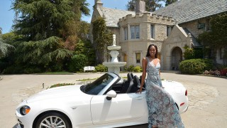 LOS ANGELES, CA - MAY 11:  2016 Playmate of the Year Eugena Washington poses with her new All-New 2017 Fiat 124 Spider at Playboy's 2016 Playmate of the Year Announcement at the Playboy Mansion on May 11, 2016 in Los Angeles, California.  (Photo by Charley Gallay/Getty Images  for Playboy)