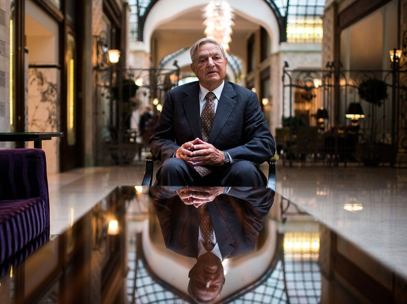 George Soros, founder of Soros Fund Management LLC, poses for a photograph following a Bloomberg Television interview in Budapest, Hungary, on Thursday, Sept. 13, 2012. Soros said he expects Spain to request a 'very limited' bailout from the European Union, with Prime Minister Mariano Rajoy seeking to avoid damaging political fallout at home. Photographer: Akos Stiller/Bloomberg via Getty Images