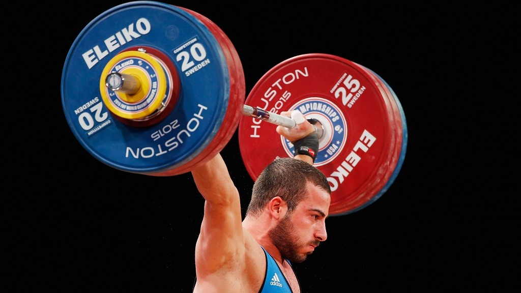 HOUSTON, TX - NOVEMBER 25:  Kianoush Rostami of Iran competes in the men's 85kg weight class during the 2015 International Weightlifting Federation World Championships at the George R. Brown Convention Center on November 25, 2015 in Houston, Texas.  (Photo by Scott Halleran/Getty Images)